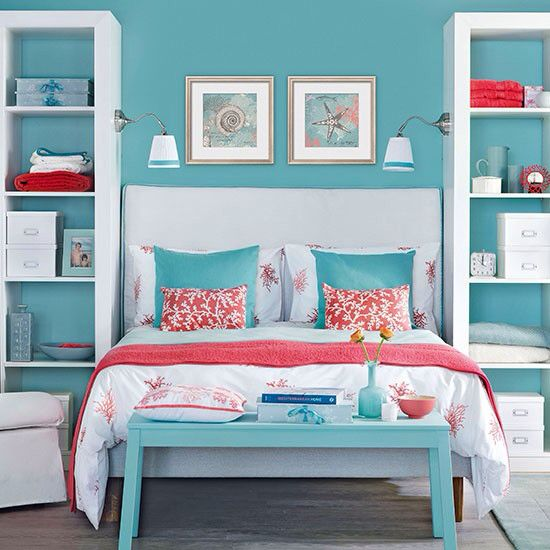Blue and White bedroom with coral accessories