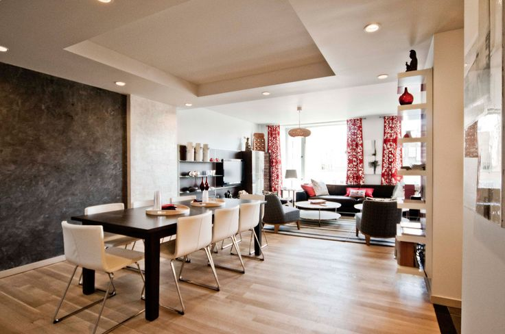 Ikea penthouse - dining room with wall shelves near the kitchen, Ikea's Stornas dining table and Bernhard leather chairs. - Craig Paulson via…