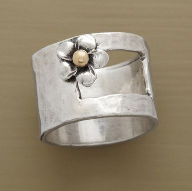 "A posy centered with 14kt gold blooms outside the window cut into our exclusive sterling silver ring. Handcrafted in whole sizes 5 to 9. 1/2""W."