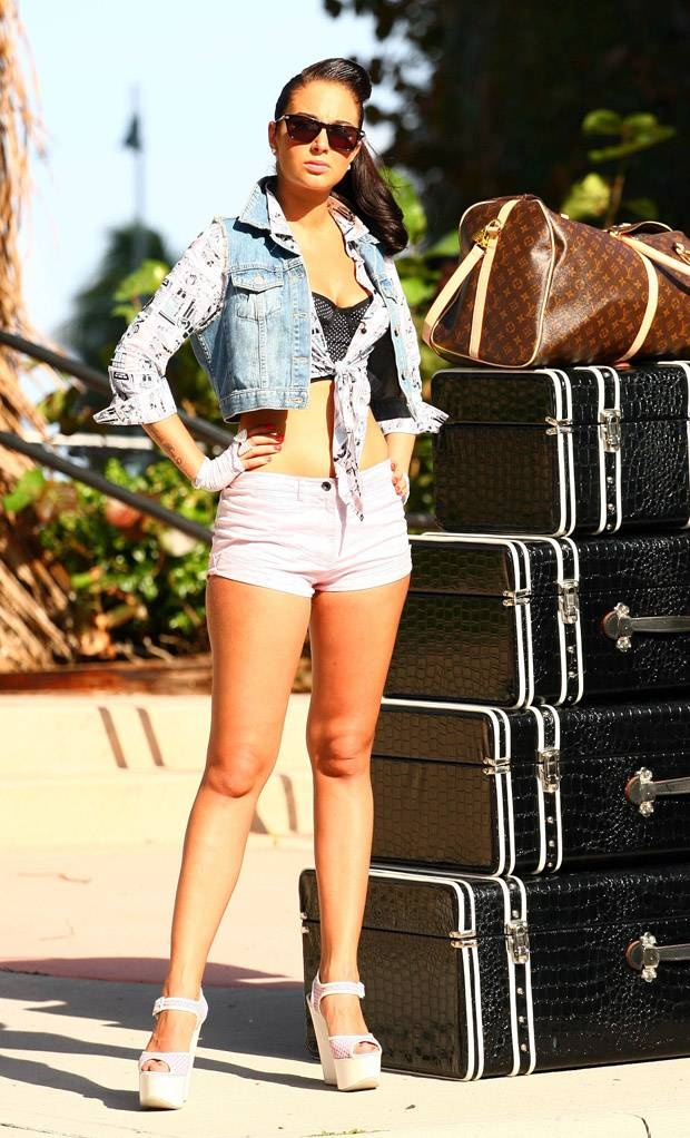 "I am obsessed with this photo of Tulisa, taken from the music video of her debut solo single ""Young"". The Louis Vuitton bag is always a nice choice as a carry-on piece."