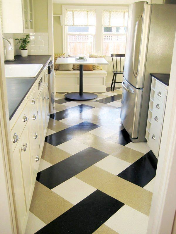 "cabinets are painted Benjamin Moore ""Old Prairie"", the counters are Paperstone in ""Obsidian"" and the floor is made of a vinyl compositio tile"