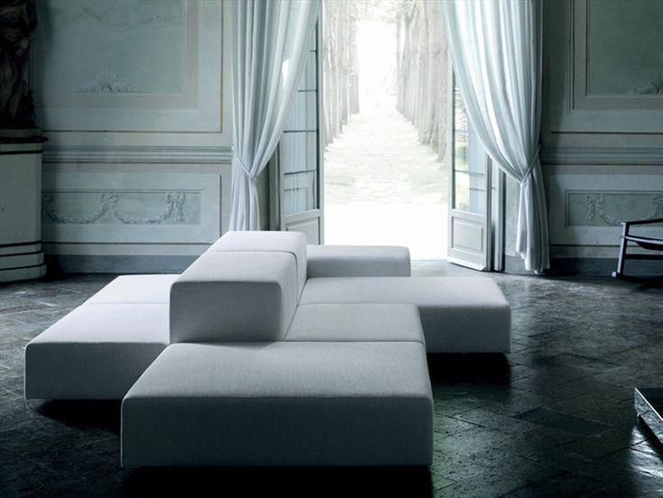 Extrawall modular seating system by Piero Lissoni for Living Divani 2002. Seats, arms and backs all independent units freely linked to create infinite configurations. And really quite comfortable...though the addition of pillows helps at GRAYE