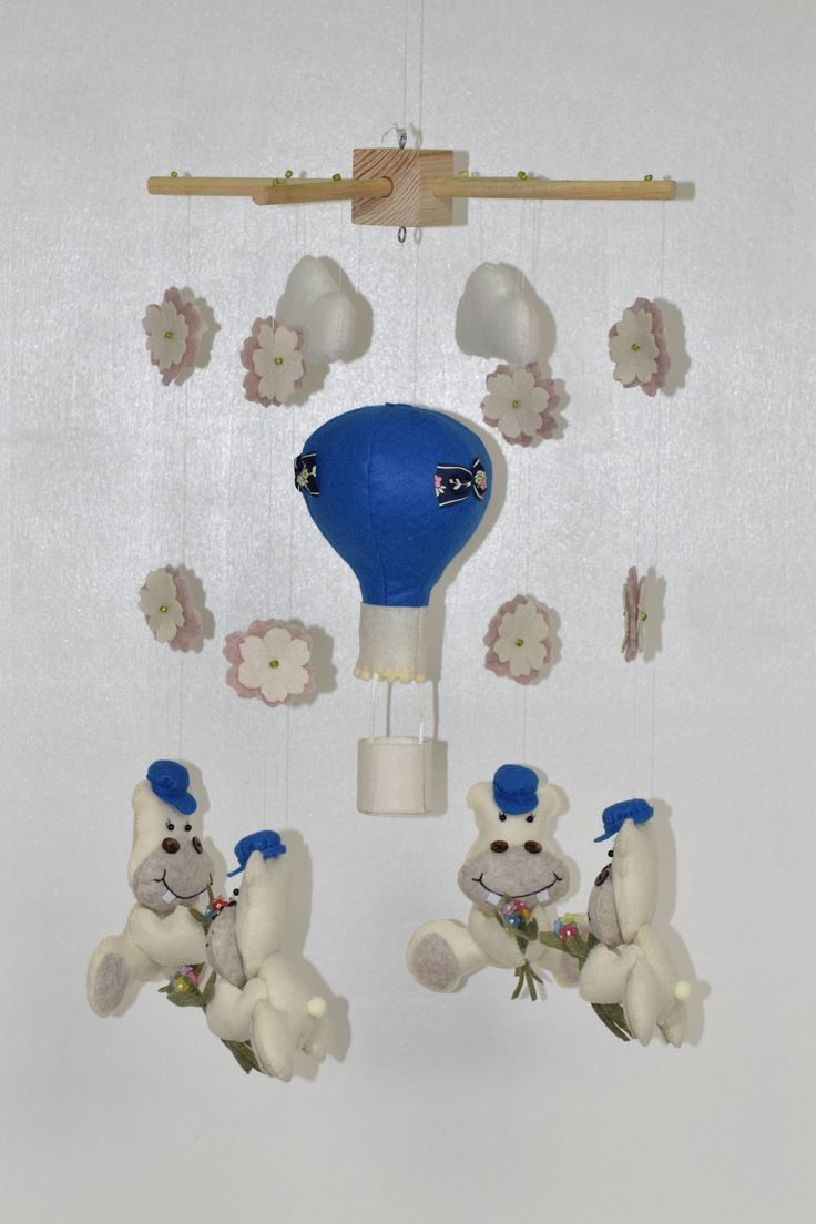 BABY MOBILE WITH HIPPOBOYS AND LITTLE BOUQUET OF FLOWERS