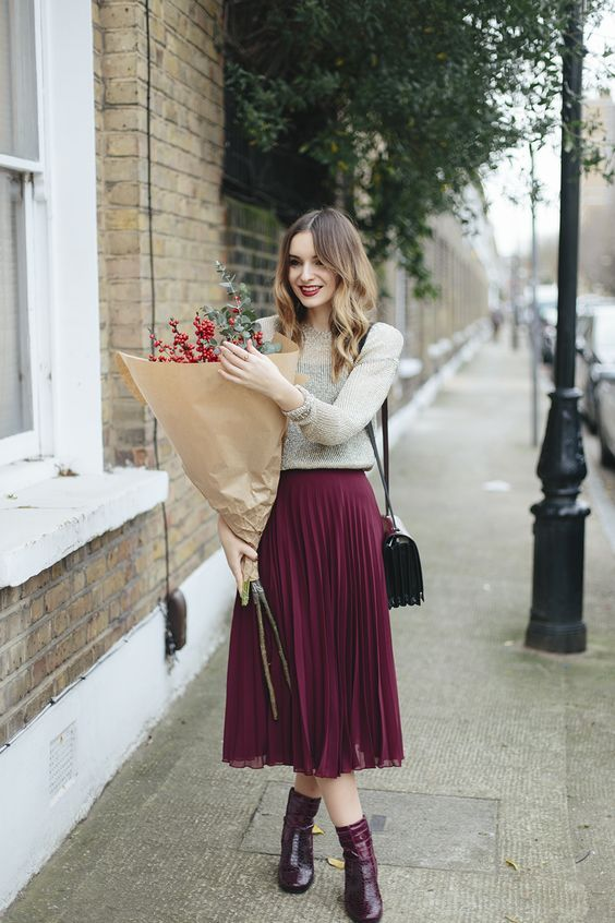 pleated burgundy midi skirt, mid calf boots, a neutral sweater and a corss body bag  so pretty!