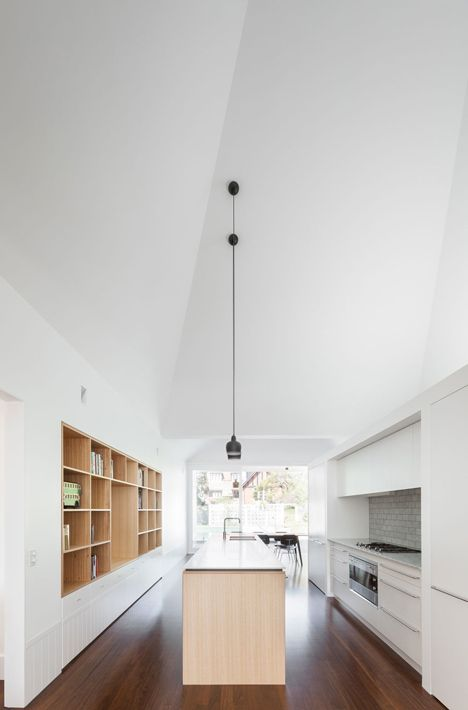 Renovated single-storey house with distorted ceiling voids by Tribe Studio. I love this kitchen plan. Galley but open.