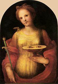 Sveta Lucija, 3. st., Sirakuza, zaštitnica slijepih, nakon mučenja joj odrubili glavu; baklja (svjetlost); mač; pladanj s očima; 1. verzija - izvađene su joj, 2. - sama ih je izvadila nakon neželjenog udvaranja, 13.12. svetkovina