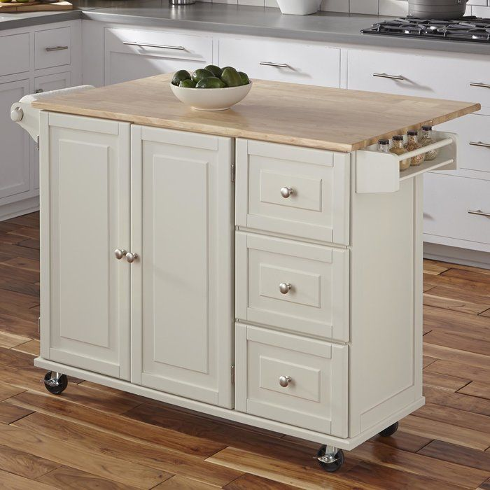 Bring both function and style to your kitchen with this understated island, the perfect anchor for your arrangement. Its clean lines and wood top pair together to give this design a traditional look that blends effortlessly into any aesthetic. Use its ample storage space to stow kitchen essentials including dry ingredients, flatware, spices, and more. Its solid rubber wood top is perfect for prepping meals or displaying a vase of romantic roses. Use its drop-leaf function to craft a…