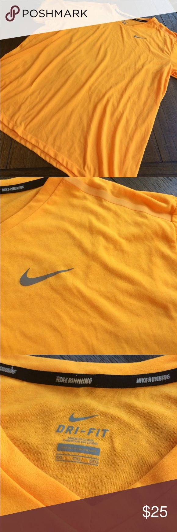Nike Running Shirt Gently used Nike Running Short Sleeved Shirt. Bright almost neon tangerine color. Stow pocket on back for key when out for a run. Dri-Fit technology wicks away moisture to keep dry. Nike Shirts Tees - Short Sleeve