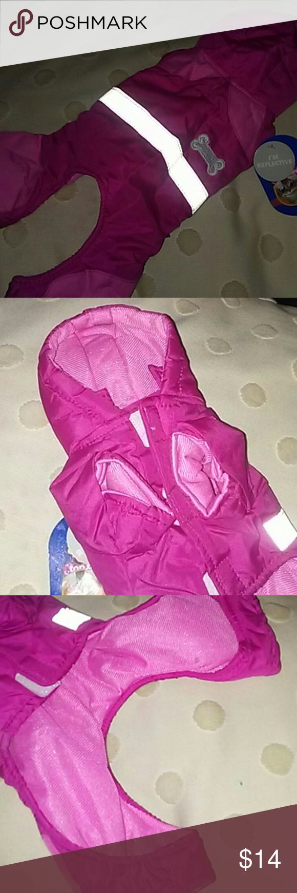 NWT Puppy/Pet Snowsuit/extra small New pink snowsuit. Reflective strip on back. Velcro closure. 100% polyester. Purchased for my dog and its too small. This is definitely an extra small. I have a yorkie poo and though she is a bit bigger than average its way too small. I would say its perfect for a Chihuahua or a toy or teacup dog. top paw One Pieces Bodysuits