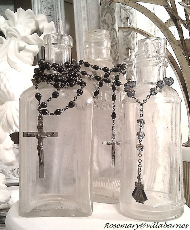 We already did this with one bottle and a rosary, but grouping several together is pretty, too.