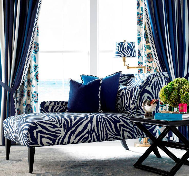 Curtains in 'Mini Deck- Indigo'. Curtain lining in 'Iznik Oasis- Santorini'. Chaise longue in 'Funky Zebra- Indigo' from the Diane von Furstenburg Collection for Kravet.