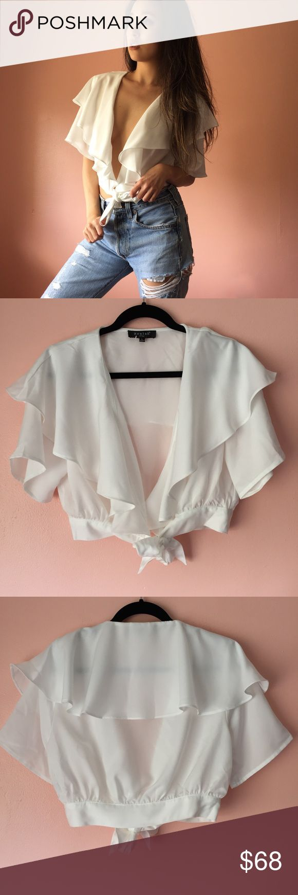 Nasty Gal Plunging Ruffle Crop Blouse Host a fiesta in this ruffled cropped blouse from Nasty Gal. Features a plunging neckline, wide ruffle collar, short sleeves, cropped silhouette with front ties. Wear with high waisted anything. New without tags. Fits a bit small like a medium. Not pinned on model. Marked size L. No returns allowed. Please ask all questions before buying. IG: [at] jacqueline.pak #nastygal Nasty Gal Tops Blouses