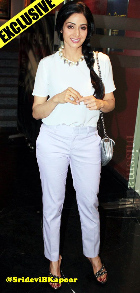 Sridevi carrying a Red Chanel Clutch. Bollywood celeb bag style.