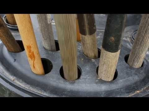 Clever way to store 18 garden tools! Drill 2'' holes into the top of a (non-contaminated) plastic 50 gallon barrel and add ~50 lbs of rocks (or gravel or sand) for stability. Brilliant!
