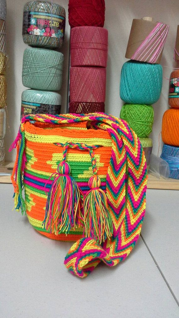 Check out this item in my Etsy shop https://www.etsy.com/listing/518521028/mini-mochila-wayuu-multicolor-yellow