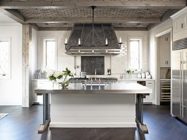 Hood And Tile Material Linda McDougald Design Fantastic Modern French Inspired Kitchen With Brick Ceiling Wood Beams Glossy