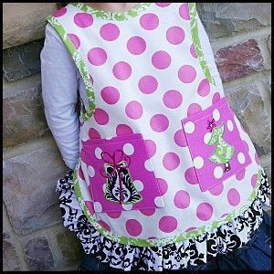 My all-time favorite apron pattern for kids.  I've made this dozens of times.  Download Child's No-Tie Apron - Sizes 2-12 Sewing Pattern | Aprons | YouCanMakeThis.com