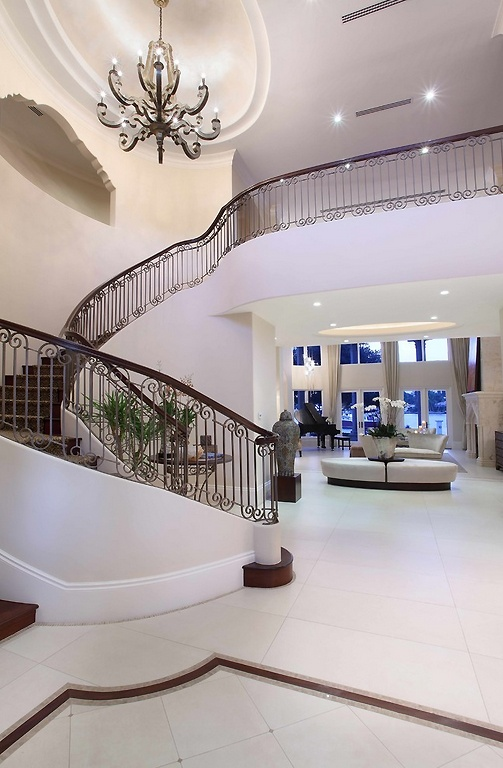 I like this stair case with the chandelier above it. I really want a second floor hallway at the top of the stairs that overlooks the first floor