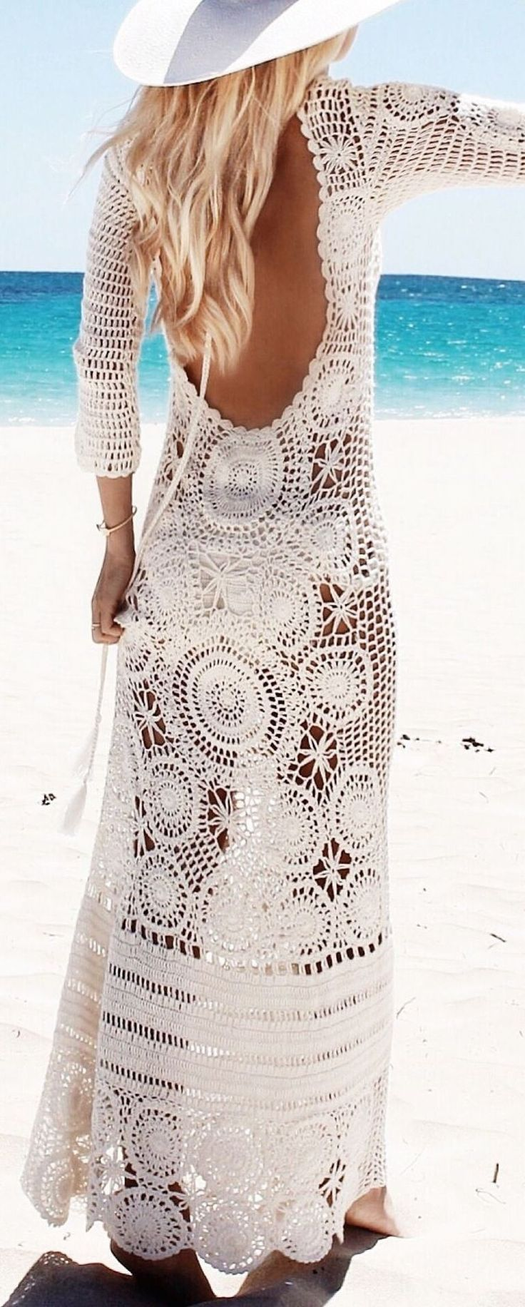 Say hello to sunny beach days with a gorgeous crochet maxi dress! It's the perfect swim cover-up when you're on a tropical getaway!