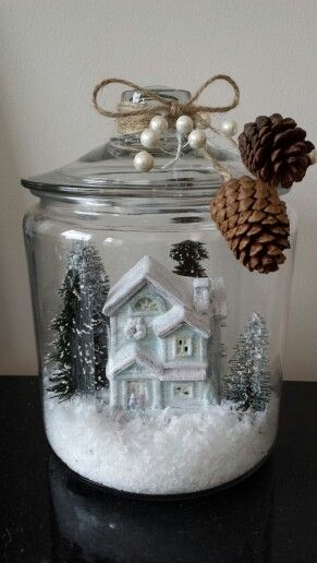 My version of village jar - Ikea canister, dollar store trees and house that I lightly painted white then glittered.