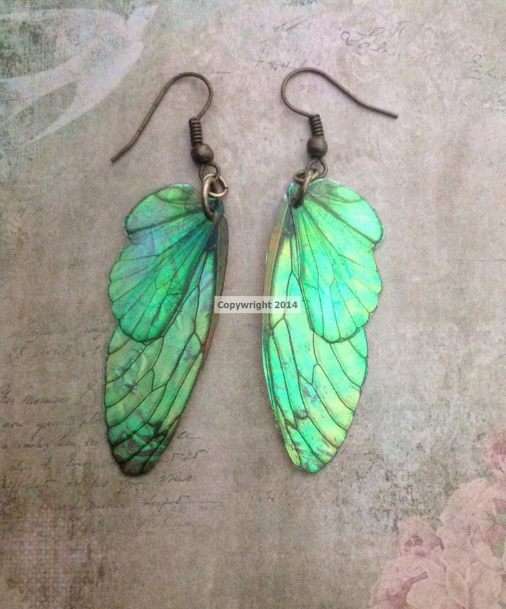 Irridescent Green/Gold Faery Wing Earrings by TheCharmedWay2 on Etsy https://www.etsy.com/listing/221804830/irridescent-greengold-faery-wing