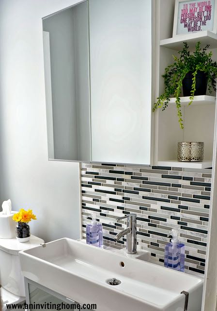Small Ikea Bathroom I love the narrow but wide sink/cabinet and glass tiles in between the sink and mirror