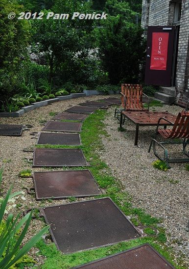 Recycled Metal Plates From A Warehouse Become Stepping Stones In This NC  Garden