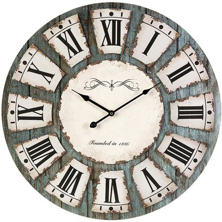 Distressed wall clock with a Roman numeral dial. Product: Wall clock  Construction Material: MDF and metal   Color:...