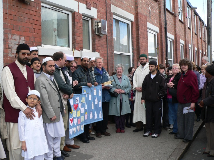 Christians and Muslims outside As-Shifa Masjid (Karimia Institute) in Nottingham on Good Friday Walk of Witness in 2008. Revd Graham Burton, former priest (retired) of neighbouring St Stephen's with St Paul's is on the right of the children's prayer banner. www.karimia.com, http://www.ststephenswithstpauls.org.uk. Joint prayers take place next to the front door of the masjid (mosque). This is still happening every year.