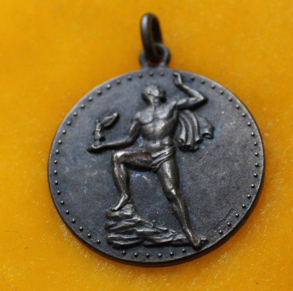 Bronze Nude Man holding tiny winged victory by JunkQueenJellyBean