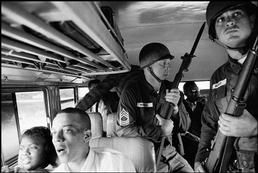 USA. Montgomery, Alabama. 1961. National Guard soldiers escort Freedom Riders along their ride from Montgomery to Jackson, Mississippi. Photo by Bruce Davidson