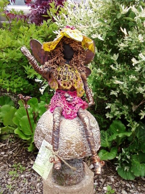 This colourful garden fairy shows how fabrics retain their original colour when you use transparent paverpol.