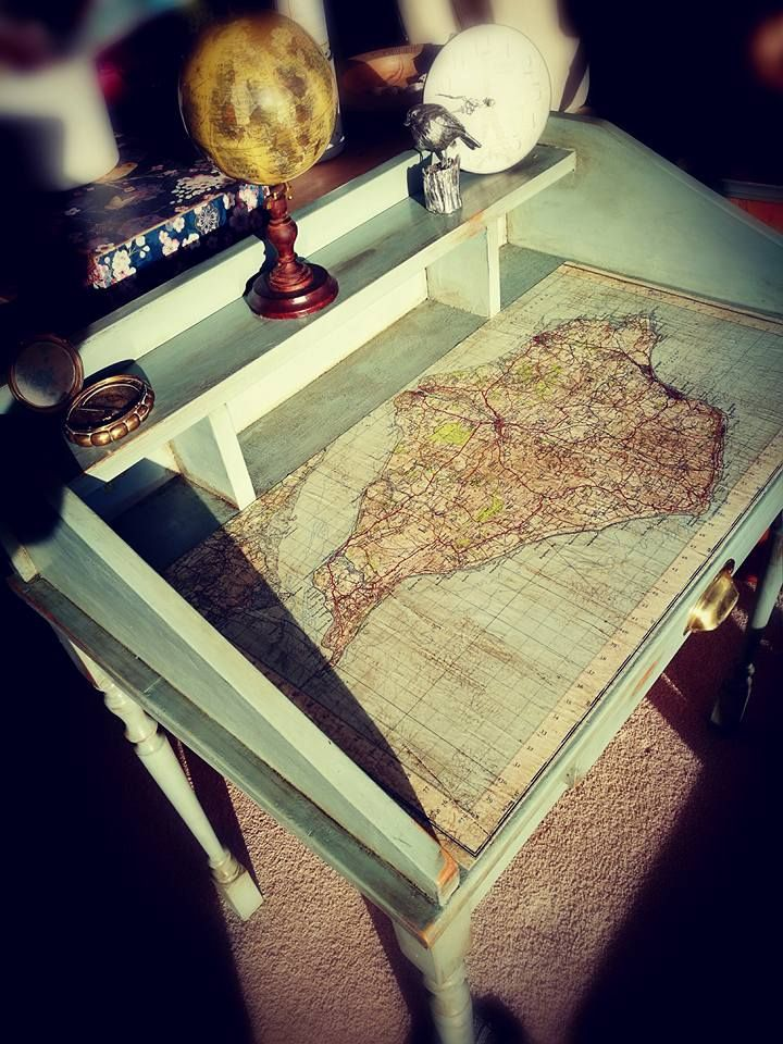 Duck egg blue chalk painted and distressed console table\desk, finished with dark wax, a decoupaged map of the Isle of Wight, and craquelure. By Melenie Ffowcs Williams.