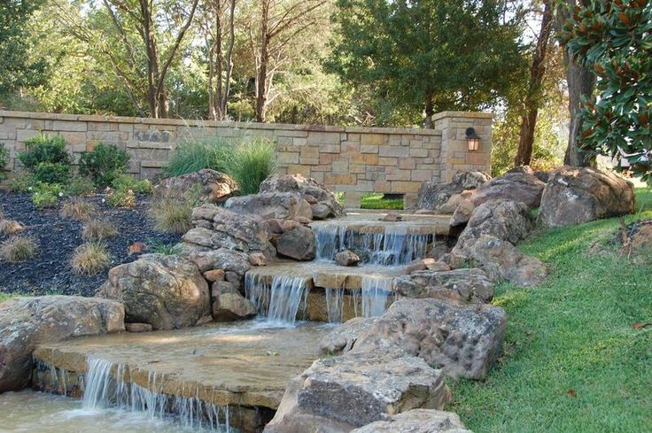 Natural stone waterfall and stream. By Outdoor Signature in Argyle, TX.