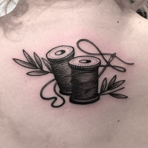 To start this off, here's a simple & lovely needle & thread tattoo by Joel Rich in Vancouver.
