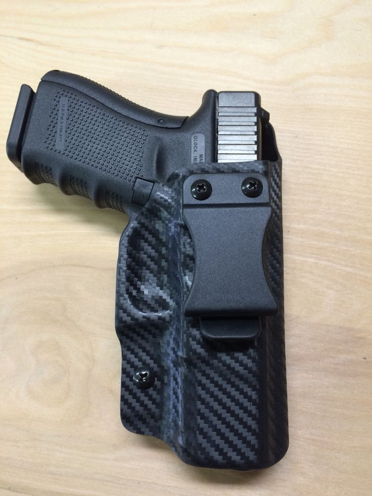 Glock 19 in a black carbon fiber kydex IWB holster. www.wolfhollowtactical.com