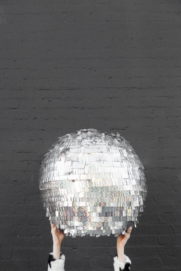 "Host your own ""Ball Drop"" for New Year's. DIY Disco Ball Piñata via Studio DIY."