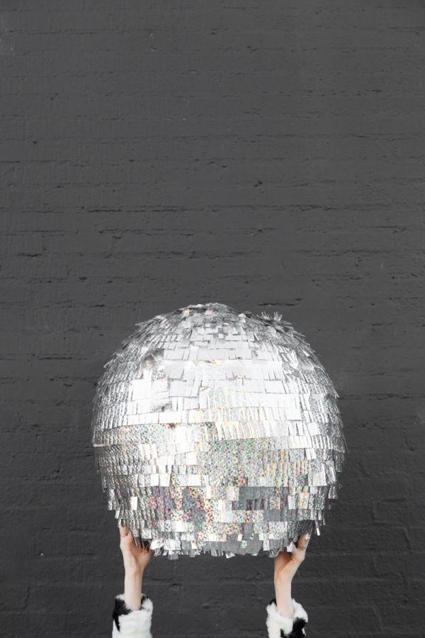 "Host your own ""Ball Drop"" for New Year's. DIY Disco Ball Piñata via Studio DIY."