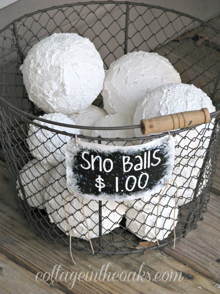 Need to put this on the porch with my decor for the holidays!  faux snow balls - Winter decorating ideas