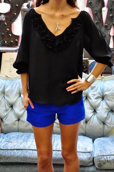 black blouse + cobalt blue shorts