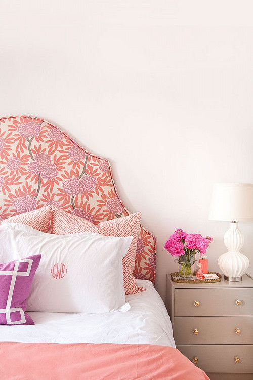 Our master bedroom is painted in Benjamin Moore's Classic Grey. I had the headboard custom made to showcase the Fleur Chinoise in Berry pattern from my textile collection. The array of pillows include Coral Fretwork and Berry signature pillow shams from my collection with Garnet Hill monogrammed linens. Our night tables are an Ikea hack, painted with gold/acrylic knobs.