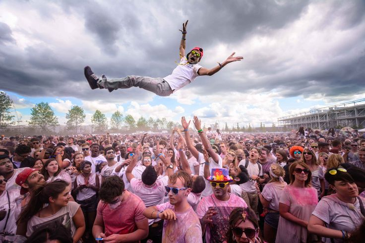 Photography Competition 2016   National Geographic Traveller (UK) Title: Lift me up Description: Revellers covered in coloured powder are lifting a fellow reveller in the air as they take part in the Holi Festival of Colours in London, September 12, 2015.