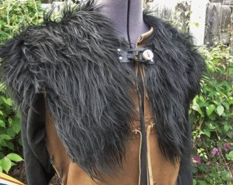 Ready to Ship -- Perfect for Vikings & warriors costumes, these fur mantles are made with high quality realistic faux fur. Wear on its own, or over a cloak to finish off a costume! Clasp is an adjustable leather loop & wooden tree branch button. Adult one size fits all. Each mantle is slightly unique, will look similar to the one pictured. Get matching leggings here! https://www.etsy.com/listing/201428250/viking-fur-leggings-boot-covers-leg?ref=shop_home_active_8   To see other colors of…