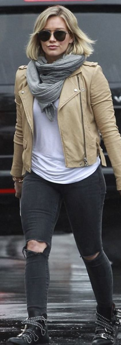 Who made Hillary Duff's tan leather jacket, black studded ankle boots, and  gray ripped