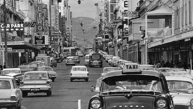 Hindley St Adelaide South Australia in 1964. Hmmm not sure what that white car in the middle is doing either.