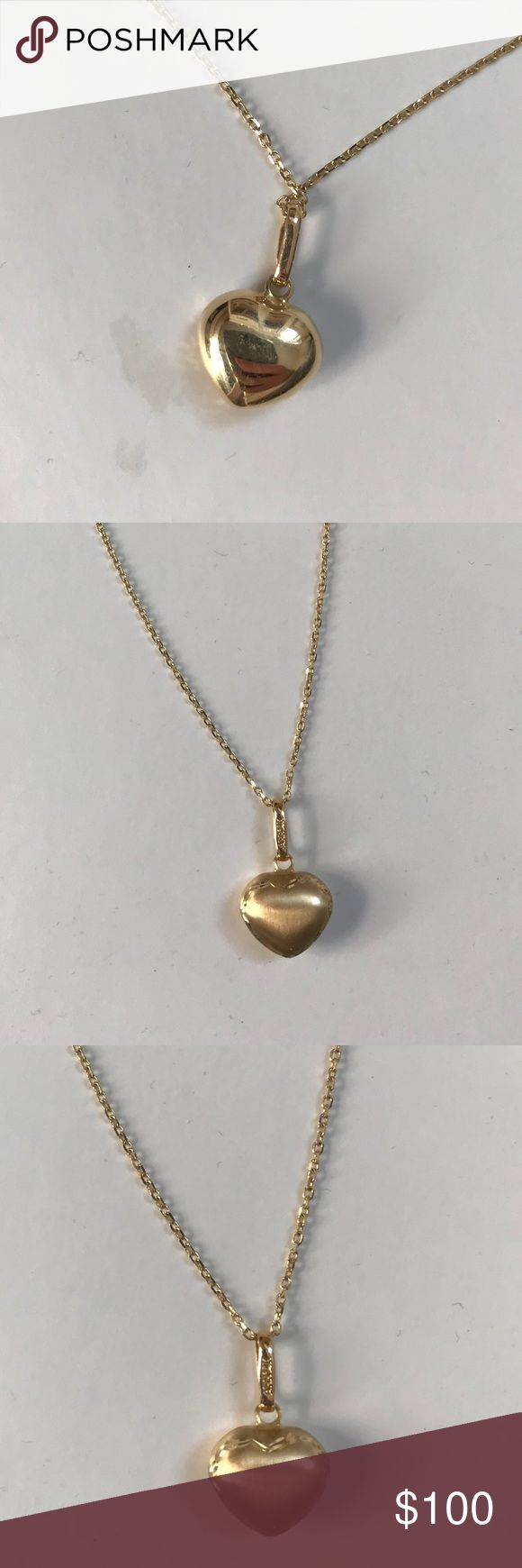 REAL GOLD HEART NECKLACE 14K gold beautiful heart necklace. Gold chain. I got it is a gift so the brand is unknown. Authentic gold!!!! Jewelry Necklaces