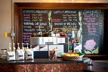 The counter setup at five leaves coffee shop is clean and for Coffee shop display ideas