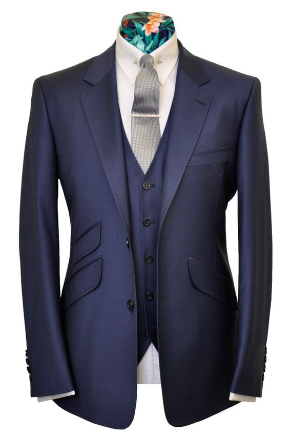 "If you have a slim body and already 1 normal suit jacket you should think something like this: Slim fit jacket with angled pockets. It works even better with peak lapel (this one has a notch lapel). It creates a time glass shape and ""shark like""..."