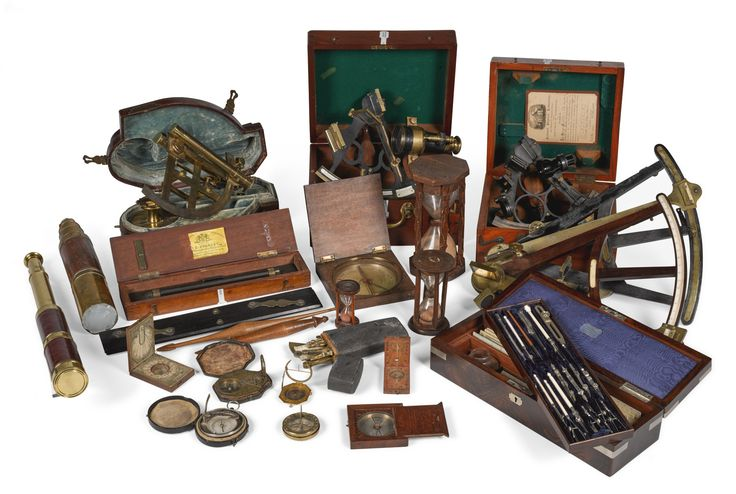 A collection of various nautical and scientific instruments, 17th-19th century comprising one cased astrolabe, three sextants, two in cases one of which labelled National Physical Laborotory, three hourglasses, seven compasses, two telescopes, two drawing sets including mounted ivory instruments and rulers, one with a fitted leather case the other with a fitted rosewood case, one spyglass, a mathematical instrument by W F Stanley in a wooden case, a folding measuring tool and two reels for…