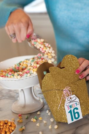 What teenage girl doesn't love a handful of sweets? Set up a candy bar, using bowls, vessels, and pedestals, then keep scoops handy. Use tags on glitter gable boxes for guests to take home.